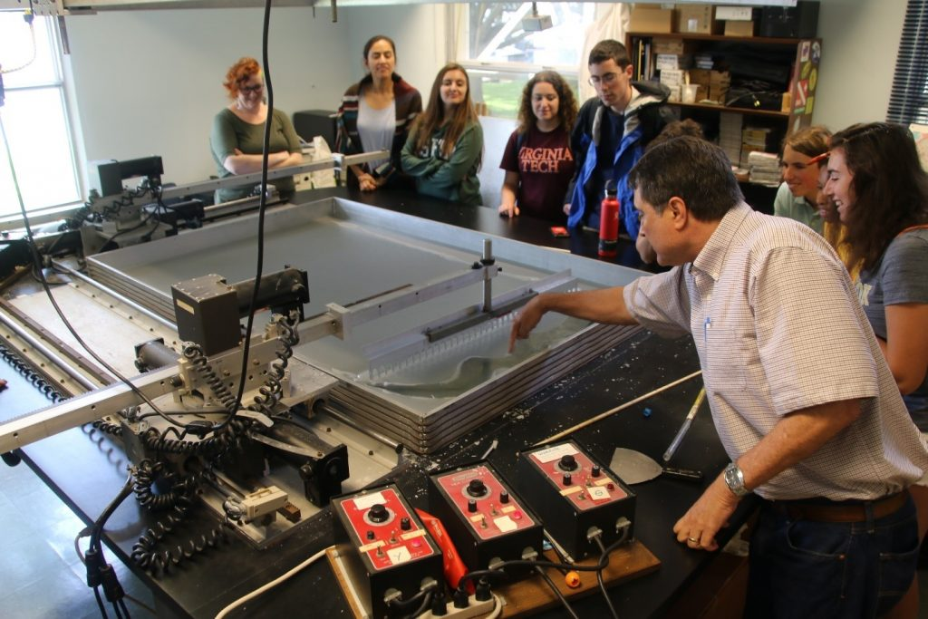 David Naar operated the wax model demo device and points out a widening gap in the surface, analogous to the rifting that occurs at mid-ocean ridges