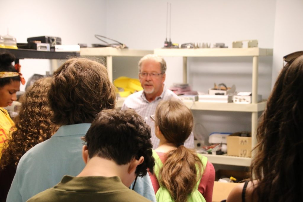 Physical oceanographer Dr. Mark Luther does a show-and-tell of ocean-sensing equipment for the REU students
