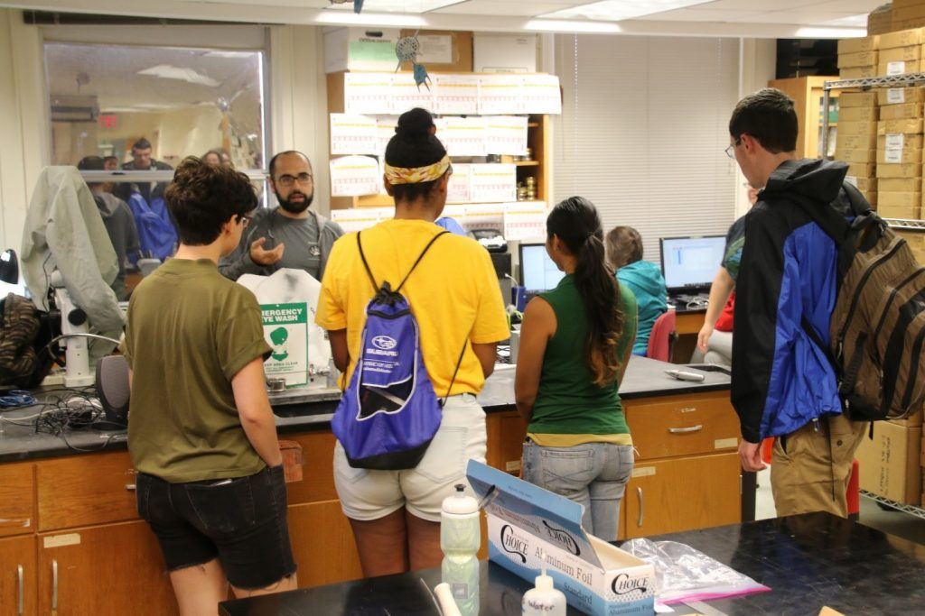 Bryan O'Malley, a senior technician in the Paleo Lab, explains to the visiting REU students how sediment cores are handled in the lab and what we can learn about paleoclimates by analyzing fossils within the cores