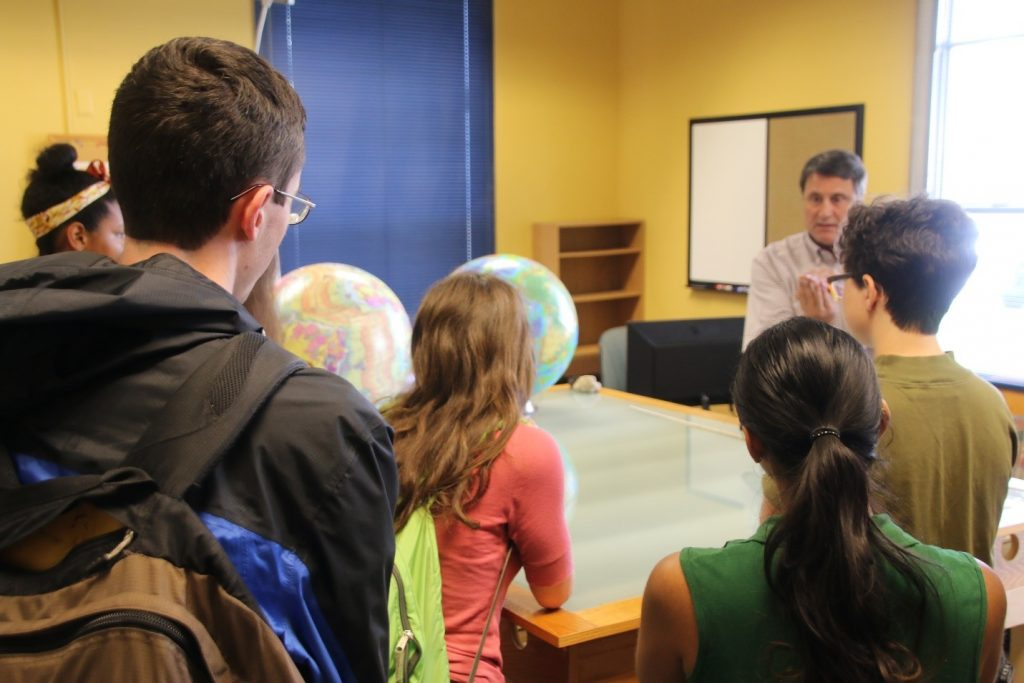 Students from the Research Experience for Undergraduates program listen to USFCMS faculty member Dr. David Naar explain the theory of plate tectonics