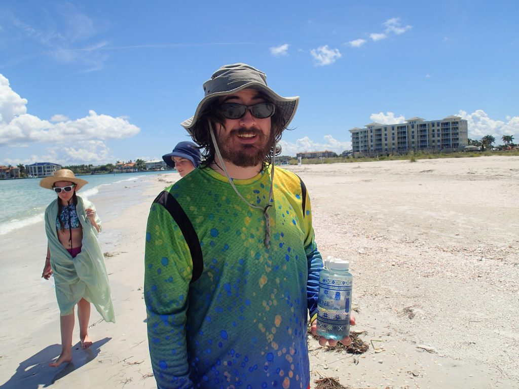 Camp mentor and USFCMS graduate student, Benjamin Ross, preparing to instruct campers on the flora and fauna of Shell Key.