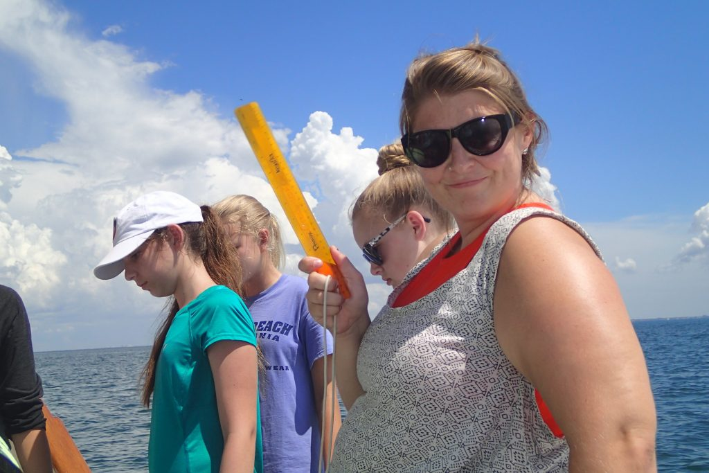 Camp mentor and USFCMS graduate student, Kate Dubickas, aboard the R/V ANGARI with campers. Photo credit: OCG Staff