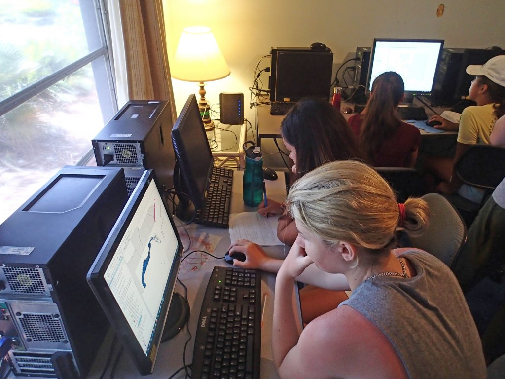 Campers utilizing ArcGIS mapping software to choose best locations to place a Marine Protected Area. Photo credit: OCG Staff