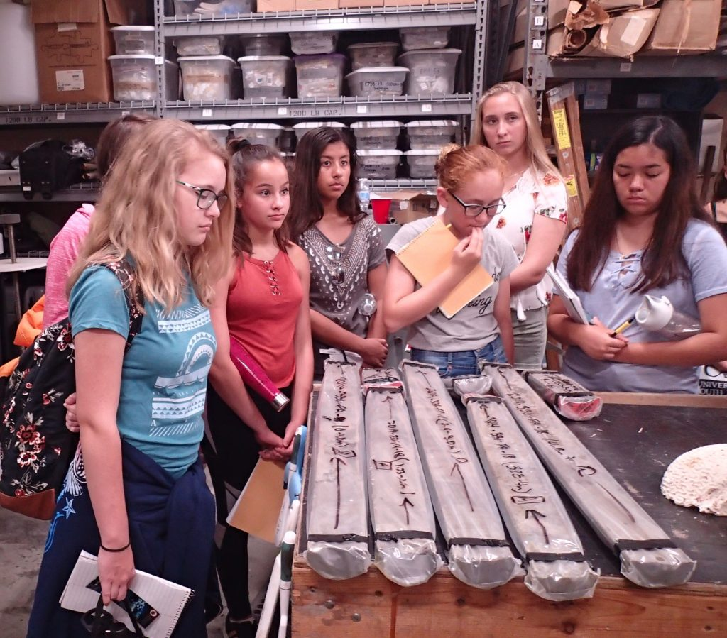 OCG campers receiving a demonstration from Jennifer Flannery of how sediment core samples are maintained at the USGS St. Petersburg Coastal and Marine Science Center. Photo credit: OCG Staff