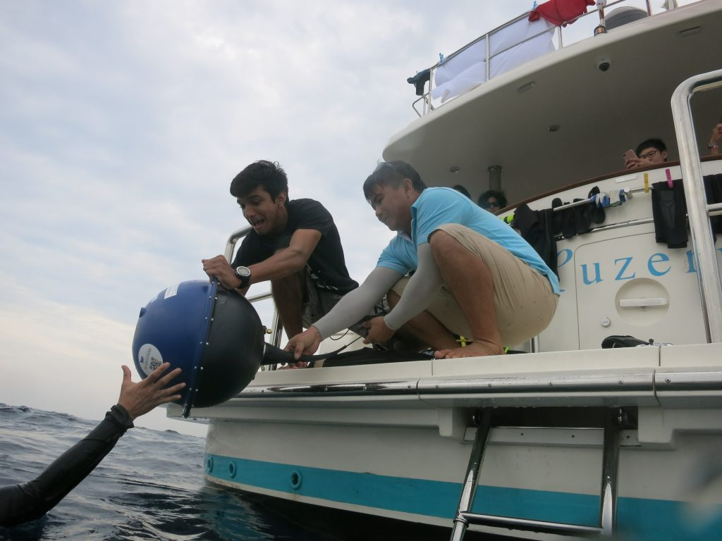 Crew deploys a surface drifter from the member yacht Luzern in the Indian Ocean