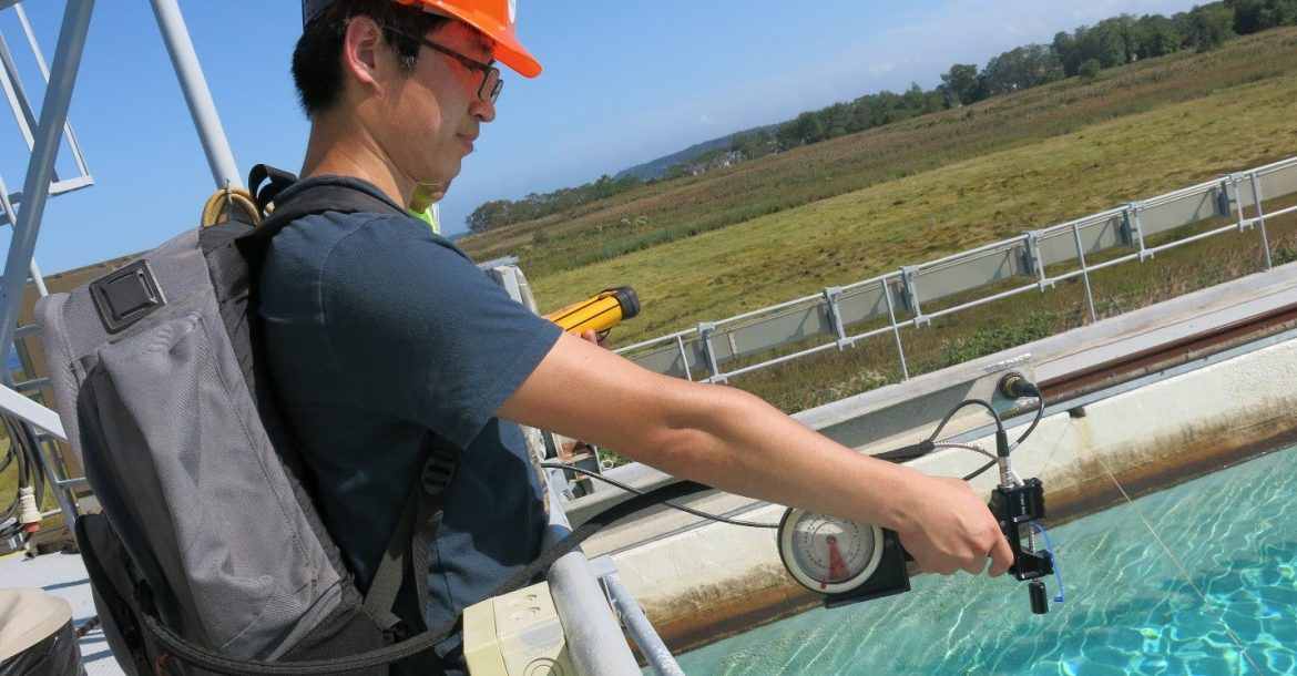 Shaojie Sun measured spectral reflectance in an oil tank experiment at the Ohmsett facility in New Jersey. Photo Credit: Ohmsett Facility