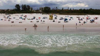 Beachgoers take in Siesta Key Beah on Wednesday. Photo Credit: Herald-Tribune Staff Photo / Dan Wagner