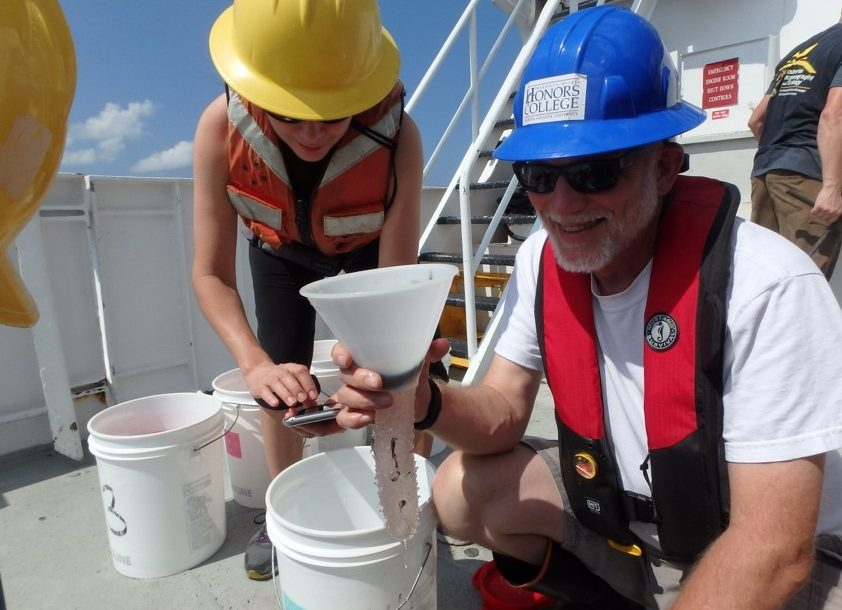 L-R) Dr. Isabel C. Romero (College of Marine Science University of South Florida) and Dr. Jon Moore (Wilkes Honors College at Florida Atlantic University) collect samples from midwater trawling that used a 10-m2 MOCNESS net during DEEPEND Consortium cruises. Photo Credit: Isabel Romero, courtesy of DEEPEND.