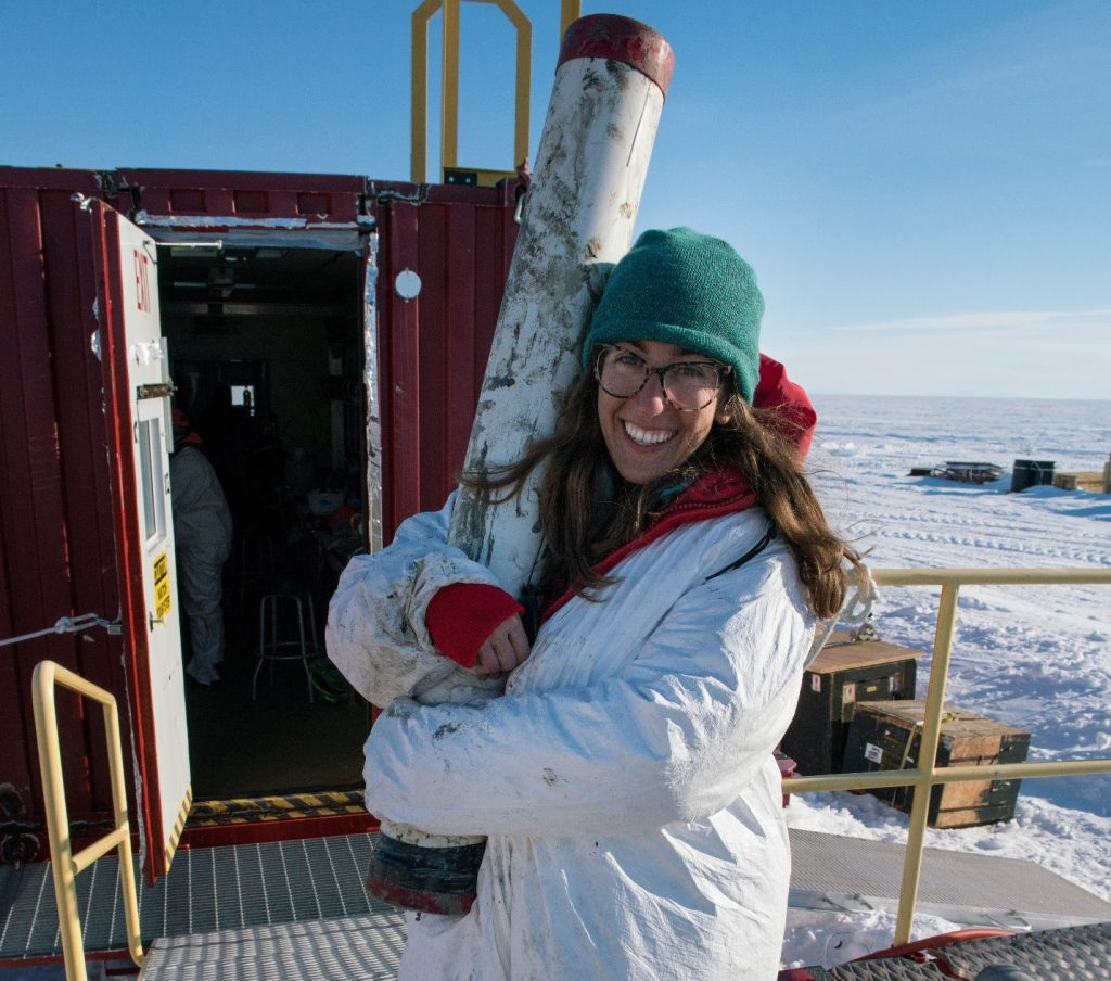 Ryan Venturelli, USFCMS Ph.D. student, holds the first ever gravity core from a subglacial lake. Photo credit: Billy Collins, SALSA