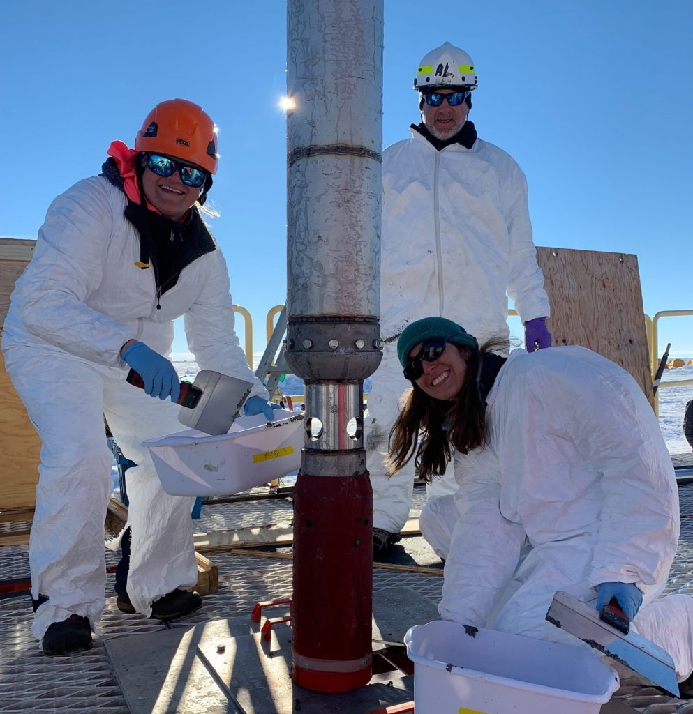 Subglacial Antarctic Lake Scientific Access team members Molly Patterson, Al Gagnon, and Ryan Venturelli (left to right) working with the gravity corer.  Photo Credit:  Kathy Kasic