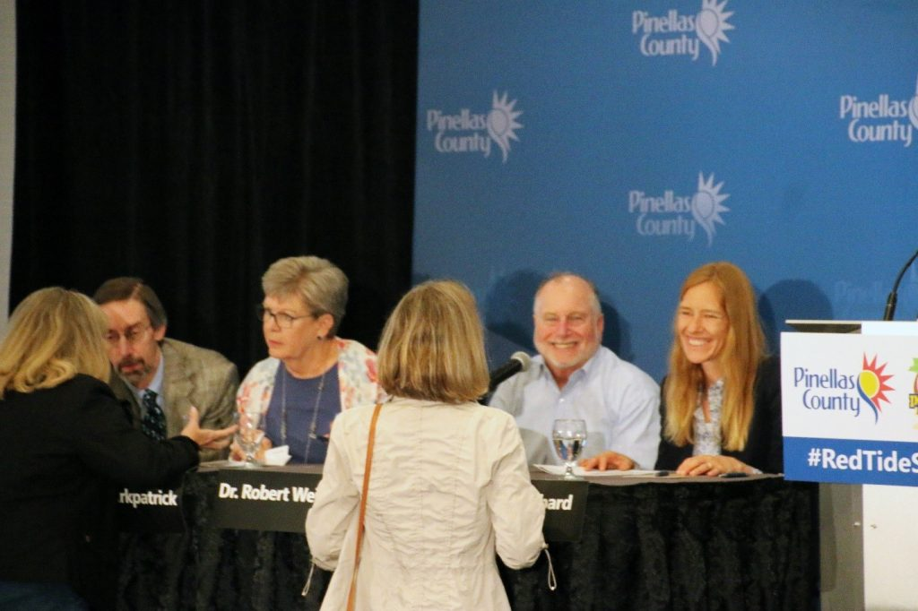 Panel scientists Dr. Richard Stumpf (NOAA), Dr. Barbara Kirkpatrick (GCOOS), Dr. Robert Weisberg (USFCMS), and Dr. Kate Hubbard (FWC FWRI) talk with audience members at the conclusion of the Red Tide Summit.