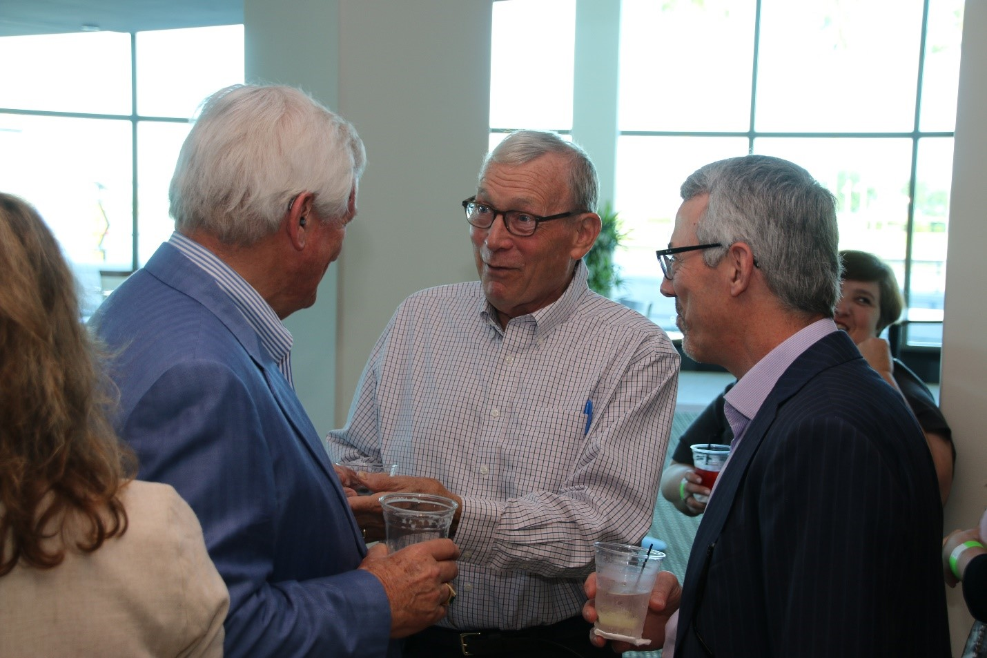 David Mearns (right) hanging out with guests at the VIP reception, including Dr. Peter Betzer (center), the founding Dean of CMS who served while Mearns was a student.