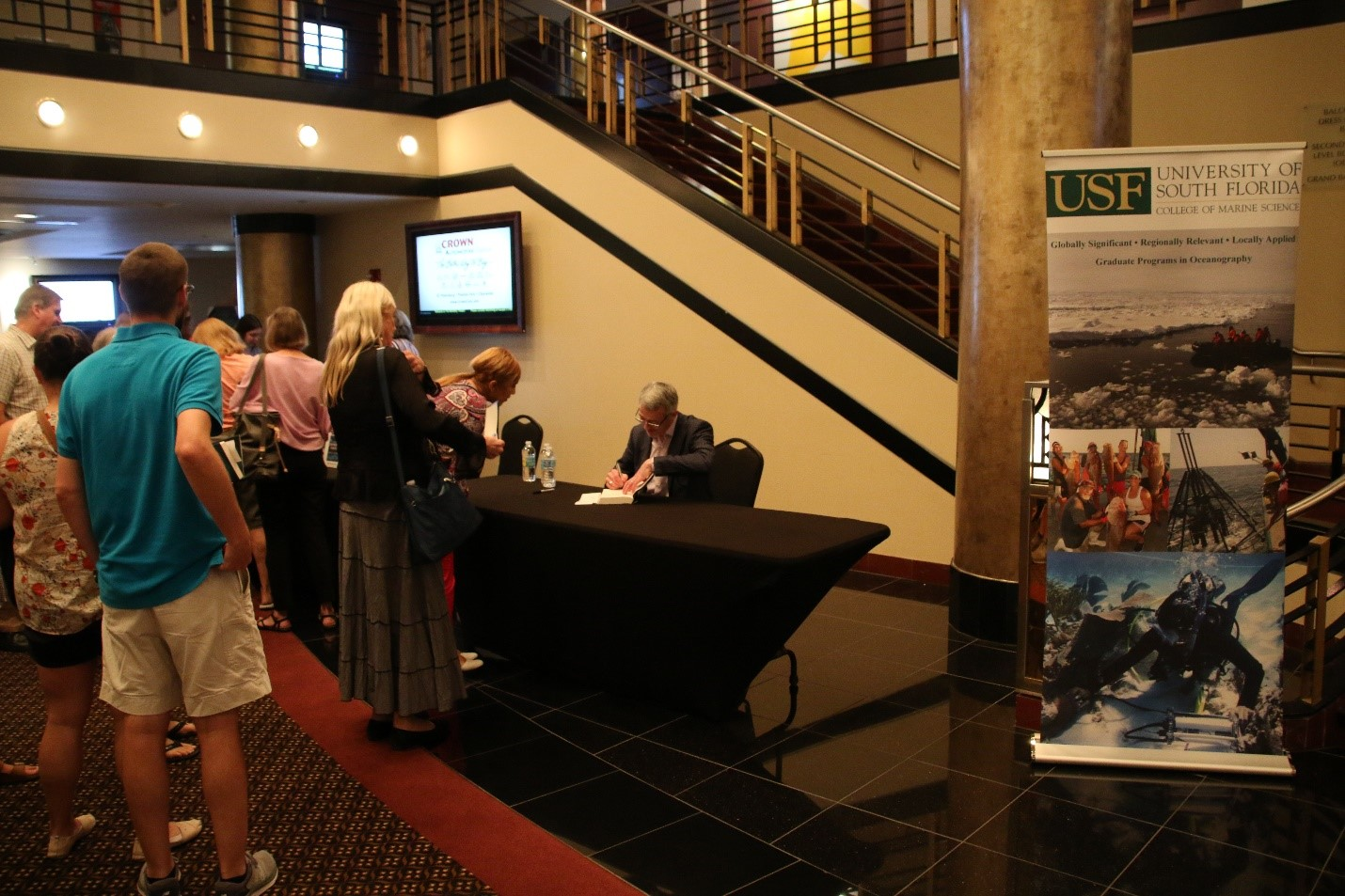 Mearns signed copies of his recent book for fans gathered in the lobby of the Mahaffey after his talk.
