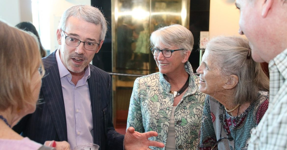 David Mearns speaks with the Dean of CMS, Dr. Jacqueline Dixon (center), and with Anne Von Rosenstiel (second from right) and family members at the reception preceding the event.