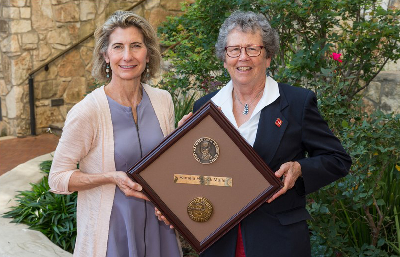 Dr. Pamela Hallock Muller receiving the Raymond C. Moore Medal from Dr. Lynn Soreghan, President of SEPM and James Roy Maxey Professor of Geology at the University of Oklahoma.
