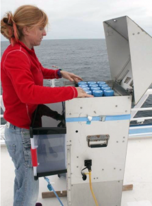 Dr. Rachel Shelley, a researcher at Florida State University and co-author of the Nature Communications study, sets up a dust collector used to capture aerosols on the R/V Knorr in 2010.