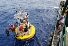 jay-law-robert-weisberg-preparing-to-board-weatherbird-ii-after-installing-wind-sensors-on-a-buoy-deployed-at-sea