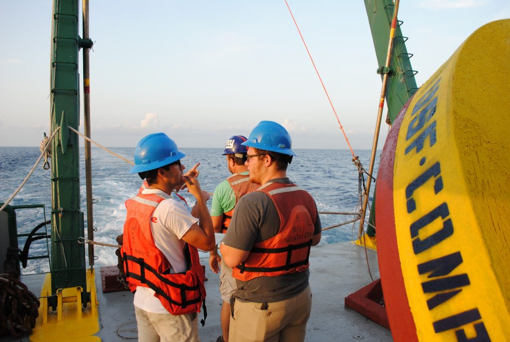luis-sorinas-morales-discussing-operations-with-sebastian-digeronimo-before-deploying-buoy