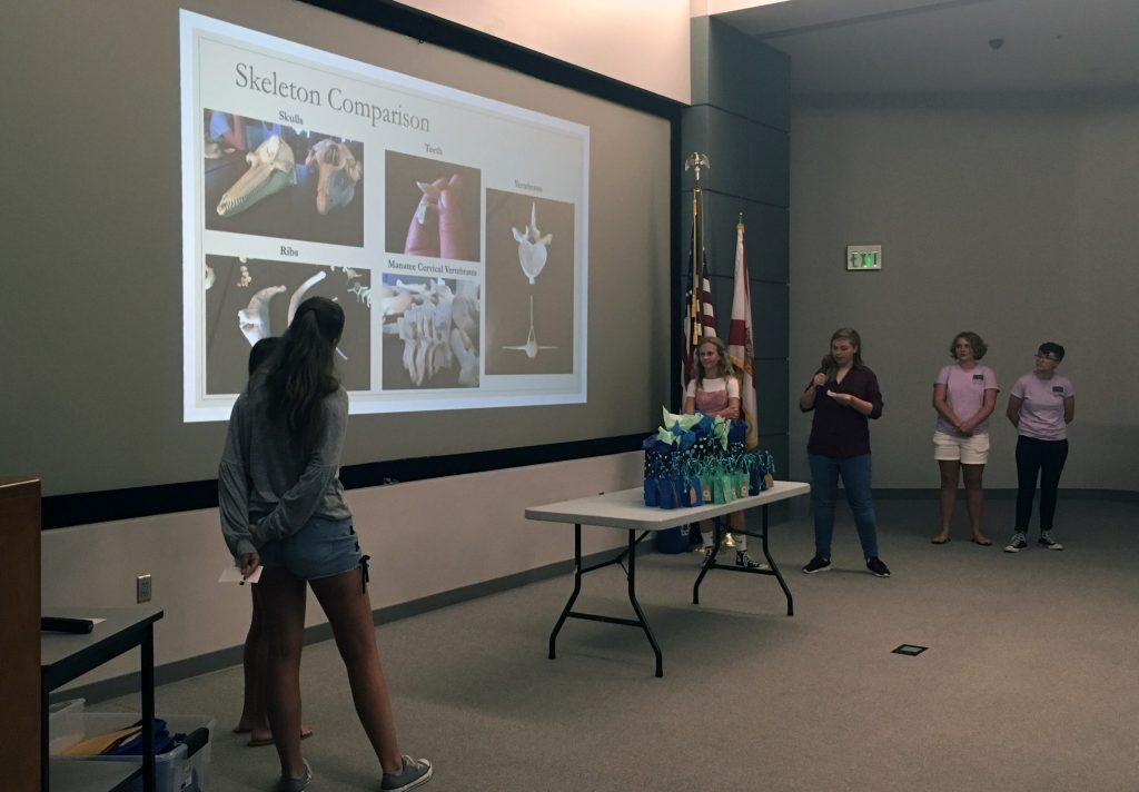 Campers describe the differences between manatees and dolphins during this year's final presentations for the Oceanography Camp for Girls.