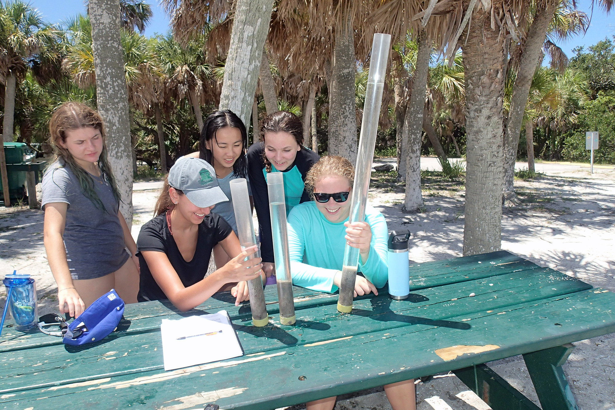Science mentor Carey Schafer discusses sediment cores taken along a transect in a seagrass bed at Fort De Soto park during this year's Oceanography Camp for Girls.
