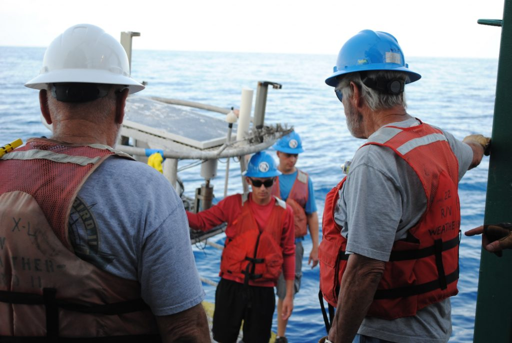 william-ely-and-talon-bullard-preparing-to-board-weatherbird-ii-after-trip-on-newly-deployed-buoy