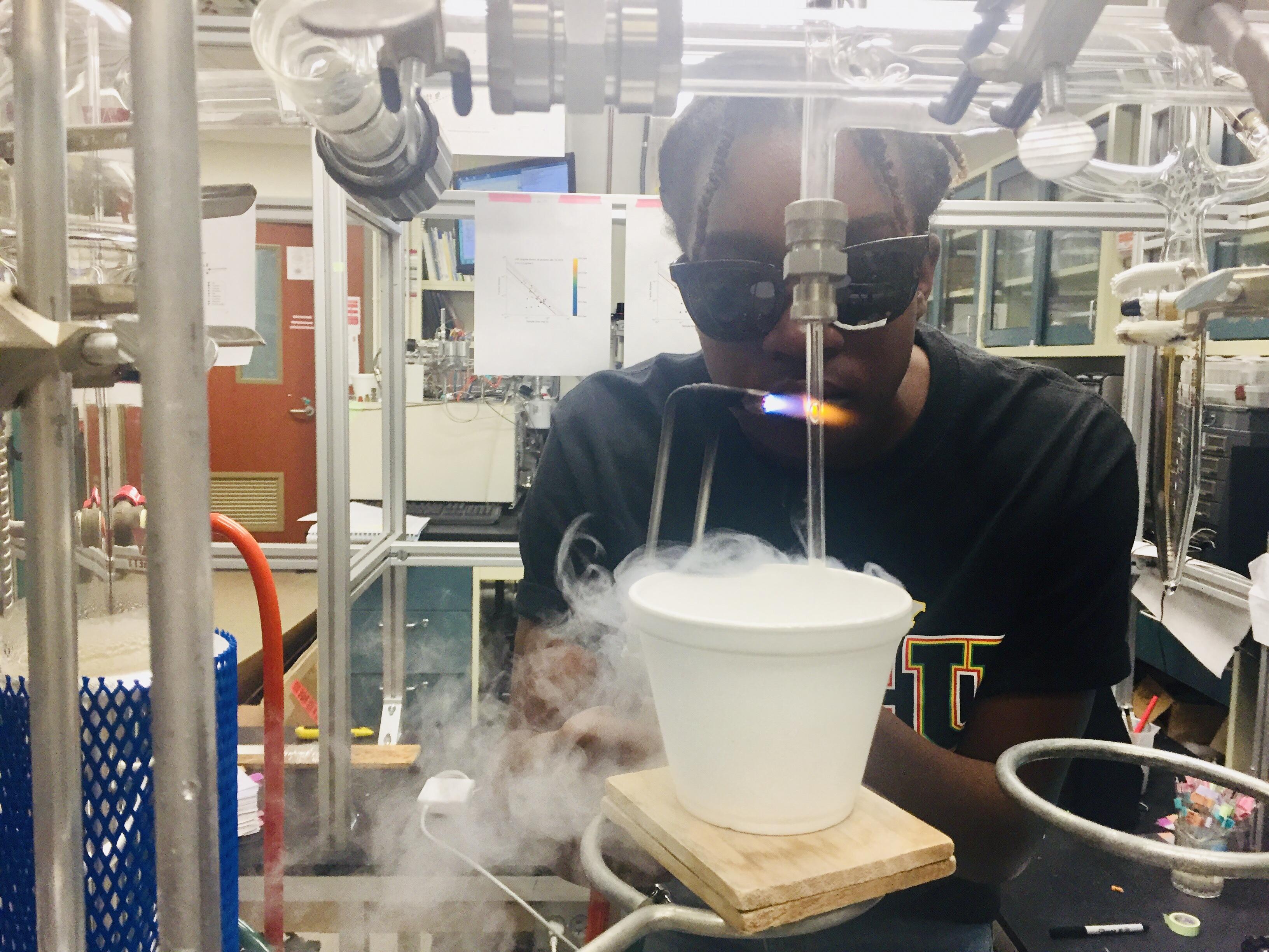 Jenelle DeVry seals her CO<sub>2</sub> sample in Brad Rosenheim's lab