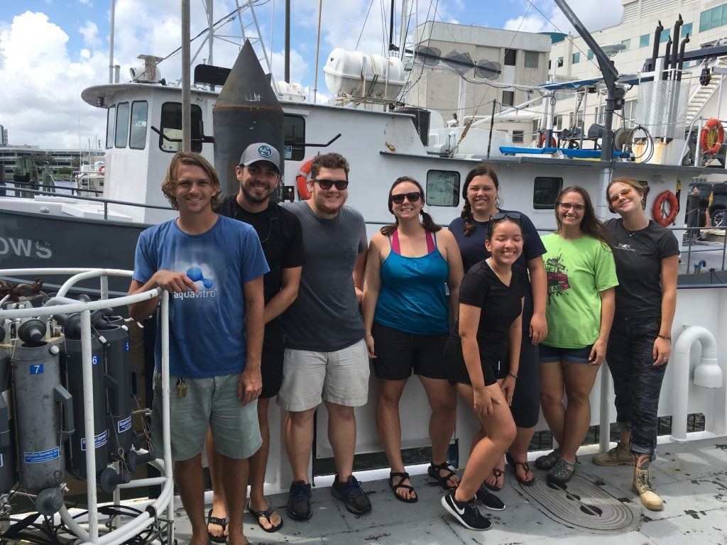 Back at port, the scientific party poses on the deck of the R/V Hogarth in front of its predecessor, the retired R/V Bellows. Left to right: Garrett Miller, Ian Williams, Sebastian DiGeronimo, Abby Blackburn, Brianna Michaud, Andrea Rodriguez Campos, Nicole Seiden, and Grace Koziol.