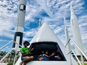 REU participants visited the Kennedy Space Center. (left to right: Jenelle DeVry, Richard Rivera, and Tione Grant)