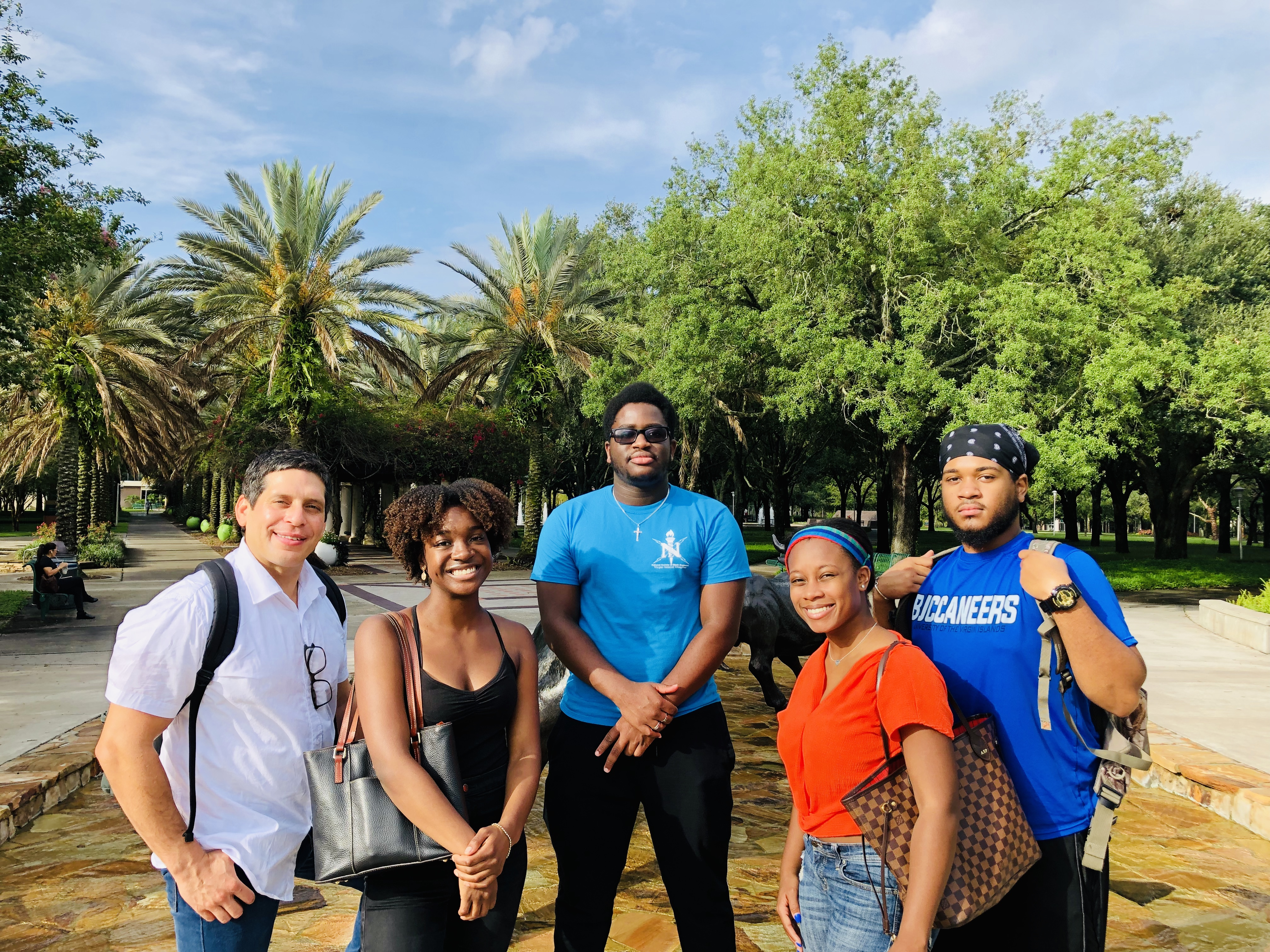 REU Participants visited USF Tampa explored the USF Tampa campus as part of their orientation for the 10-week REU program, sponsored by the National Science Foundation. (left to right: Richard Rivera, Jenelle DeVry, Tione Grant, Alexis Peterson, and Angel Cedeño)
