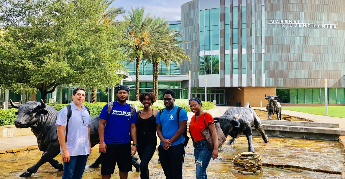 REU participants attended a lunch hosted by Sloan UCEM at USF Top of the Palms with Bernard Batson and COE students. (left to right: Richard Rivera, Angel Cedeño, Jenelle DeVry, Tione Grant, and Alexis Peterson)