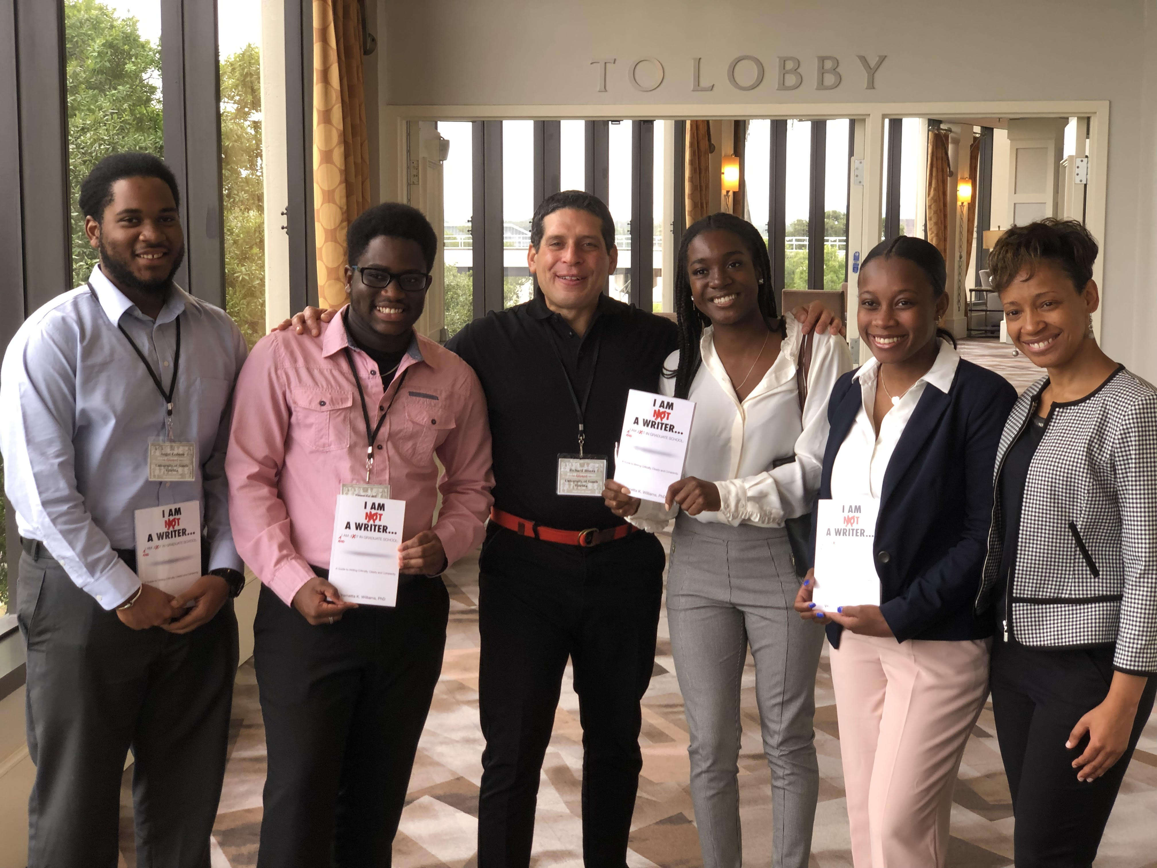 REU Participants attended a McKnight Conference in Tampa (left to right: Angel Cedeño, Tione Grant, Richard Rivera, Jenelle DeVry, and Alexis Peterson)
