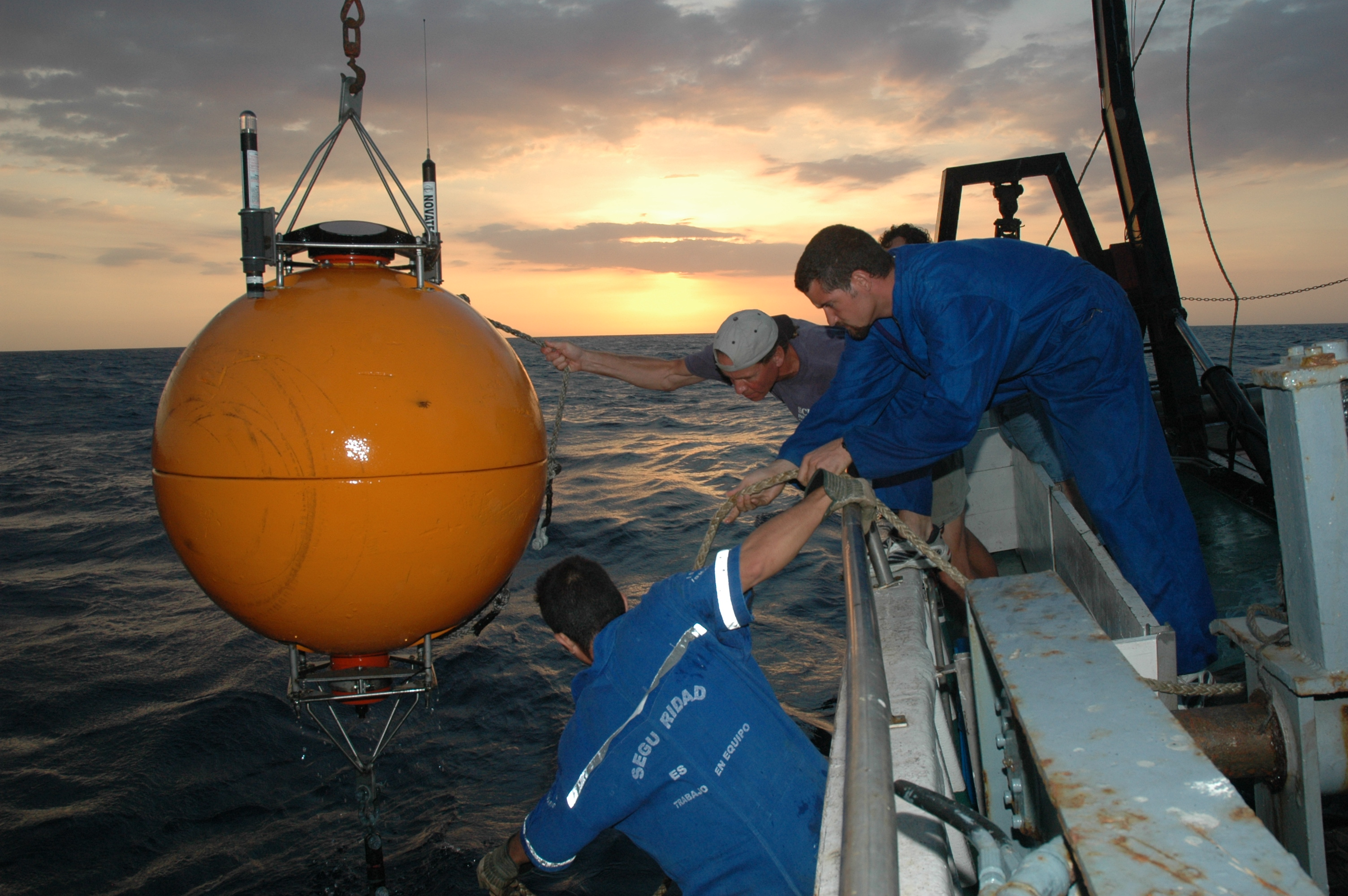 A CARIACO team recovers the buoy that housed the Acoustic Doppler Current Profiler (ADCP). Data from the ADCP revealed a daily migration of fish into and out of the anoxic waters in the morning and evening.