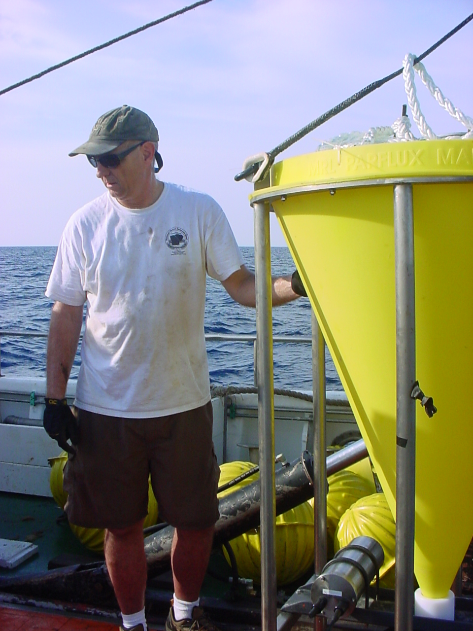 "Robert ""Bob"" Thunell (University of South Carolina) was the principal investigator for the study of sediment fluxes at the CARIACO basin (posing here with a cone-shaped sediment trap ready for deployment)."