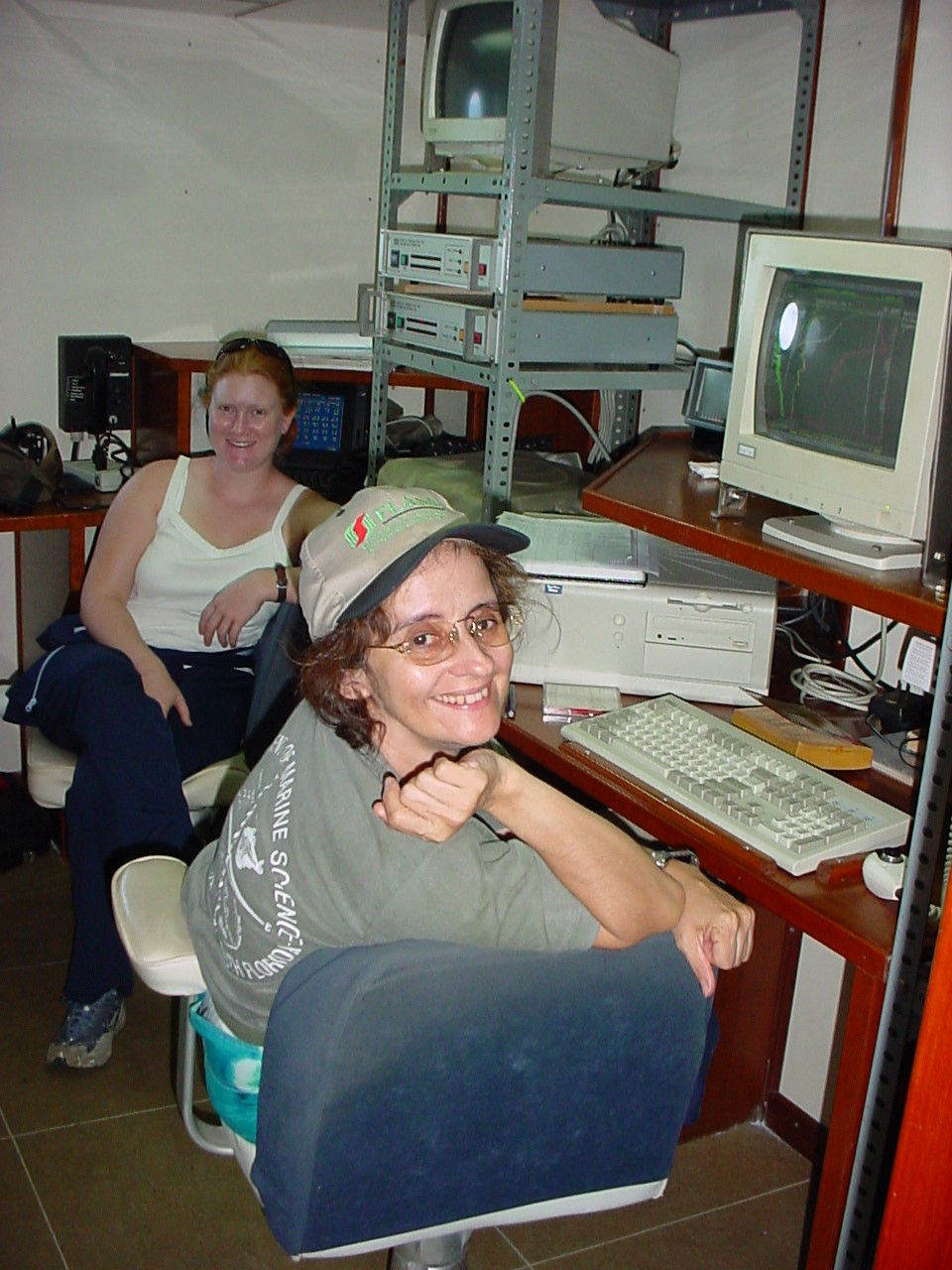 Yrene Astor from the Fundación La Salle de Ciencias Naturales (right) and Michelle McIntyre from USF (left) monitor the rosette-CTD deployment and seawater sampling.