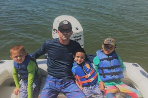 Shane Dunn enjoying time fishing with his three boys