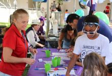 Dr. Christina Simoniello guides young students through an activity at the GCOOS booth during the 2017 St. Pete Science Festival.