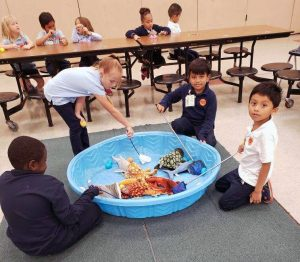 1st graders fishing for their eggs.