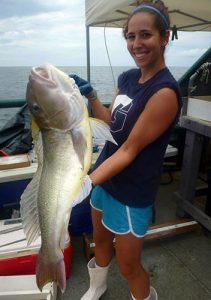 The lead author, Susan Snyder, holds a tilefish caught for the study in the northern Gulf of Mexico.