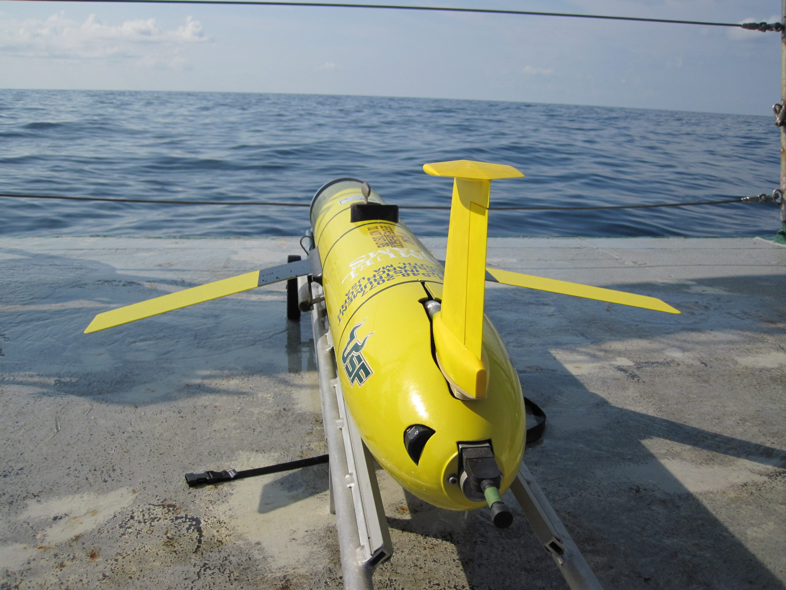 USF Glider prepared for deployment in the northern Gulf of Mexico for researching water column properties near the Deepwater Horizon oil spill in May 2010. (Vessel R/V Weatherbird, photo credit Andrew Warren)