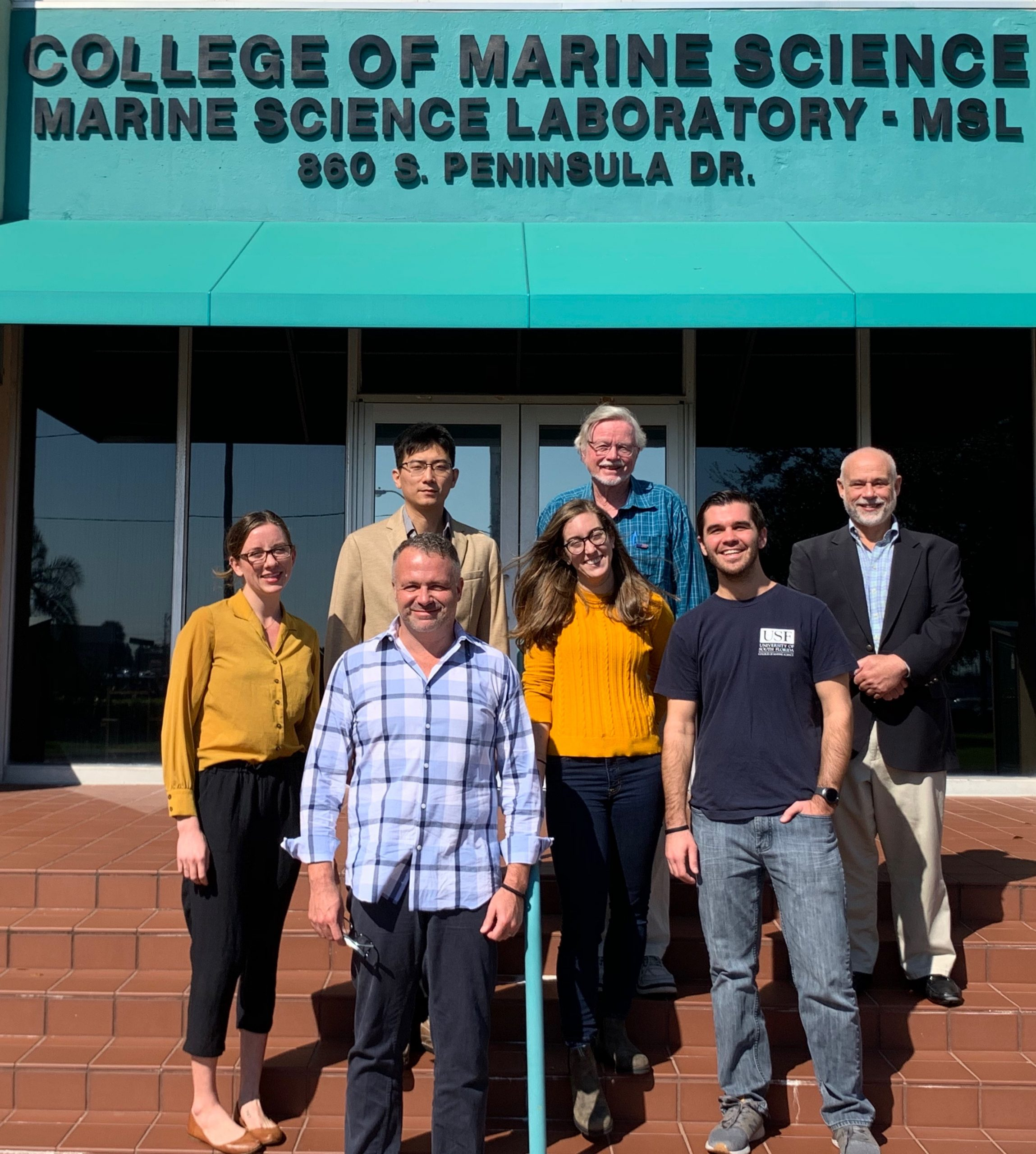 From left to right, back row, Bea Combs, Jing Chen, Professor Al Hine, Mr. Jim Aresty. Front row: Mr. Jason Mathis, Ryan Venturelli and Jonathan Sharp. Not pictured: Ellie Hudson-Heck.