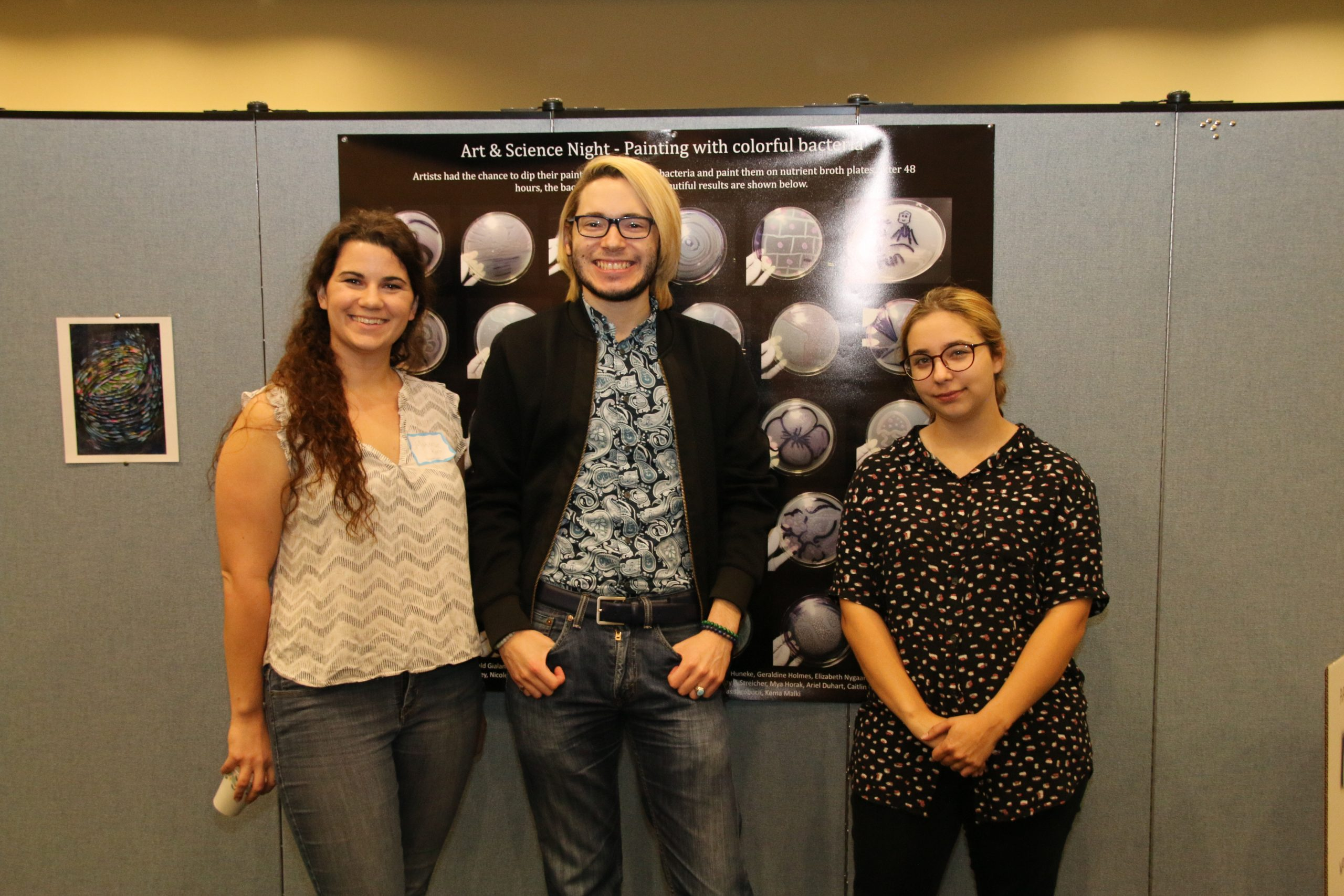 Makenzie Kerr (College of Marine Science), Antonio Permuy and Grace Stocksdale (The Collection art club) planned and coordinated the art exhibit.