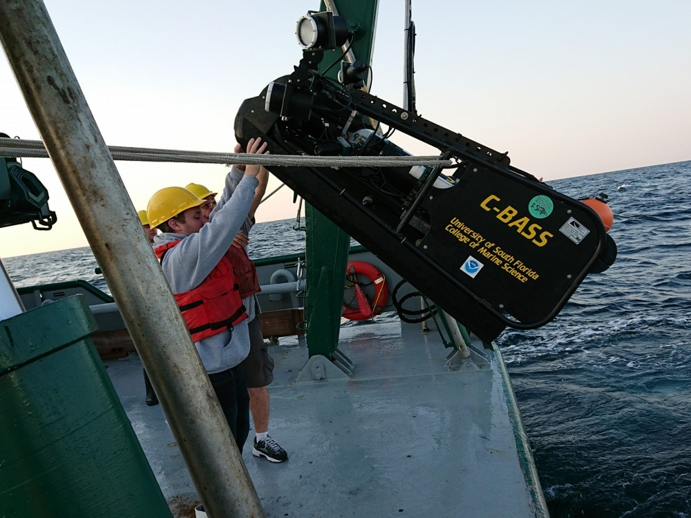 Deployment of video tow platform C-BASS in the eastern Gulf of Mexico in April 2019 (in photo Alex Ilich, Alex Silverman, Vessel R/V Weatherbird, photo credit Chad Lembke)