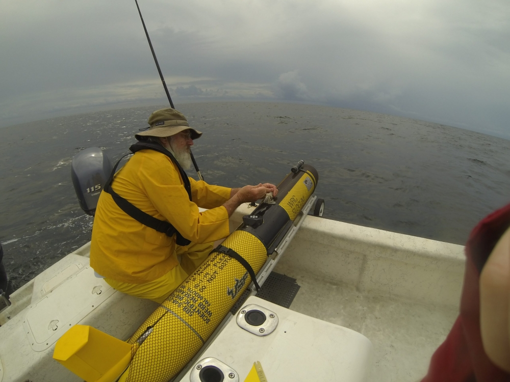 USF glider Bass being prepared for deployment off Tampa Bay in the Gulf of Mexico in 2014 to obtain water column variables in support of understanding red tide evolution and progression. (In photo Steve Butcher, FWRI Vessel Hab Hunter, photo credit Matt Garrett)
